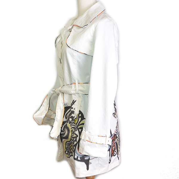 Side view of pre-owned Carlopik Graphic Printed Trench Coat, with belt and buttons.