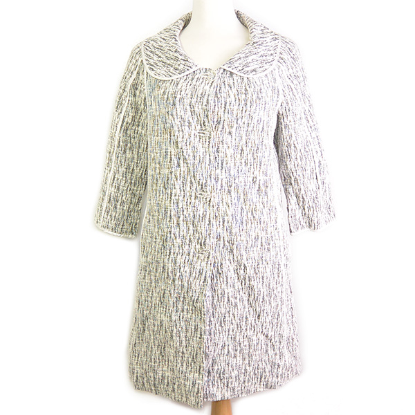 On sale pre-owned Cynthia Steffe Printed Light Coat in black and white, with round collar and clear front buttons.
