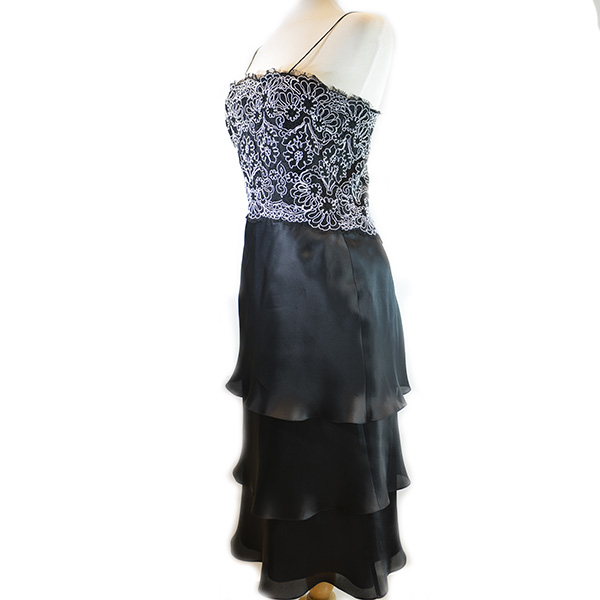 Side view of on sale pre-owned Frascara Midi Silk Dress without shawl, with black and white lace upper detail and pleated lower.