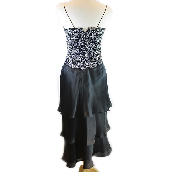 Back view of on sale pre-owned Frascara Midi Silk Dress without shawl, with black and white lace upper detail and pleated lower.