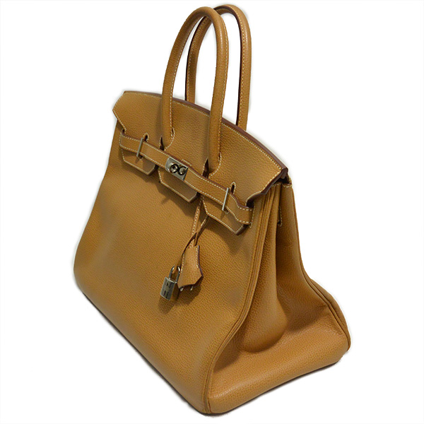 Side view of pre-owned Hermes Paris Birkin Clemence 35 Bag in tan, with palladium-plated hardware.