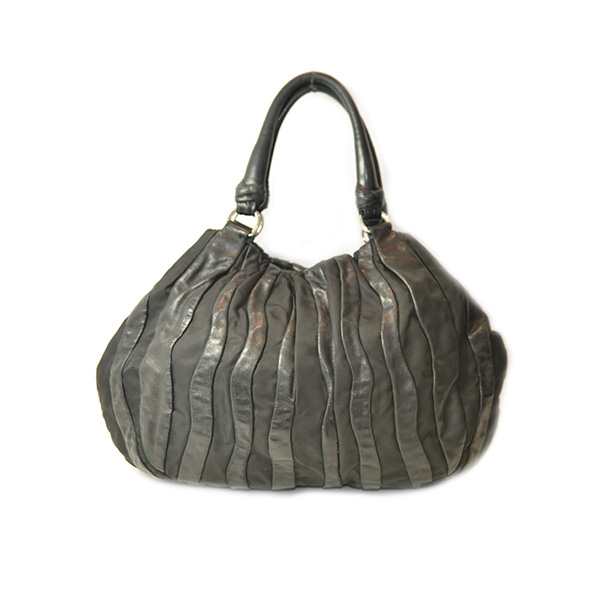 Back view of on sale pre-owned Prada Nylon Leather Quilted Shoulder Bag in black with slouch design and double leather handles.