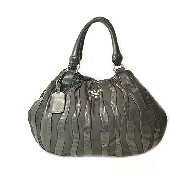 On sale pre-owned Prada Nylon Leather Quilted Shoulder Bag in black with slouch design and double leather handles.