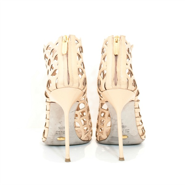 Back view of on sale pre-owned Sergio Rossi Scallop-Cutout Booties in beige, with rear zip closure.