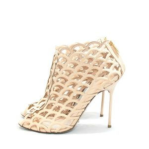 On sale pre-owned Sergio Rossi Scallop-Cutout Booties in beige, with rear zip closure.