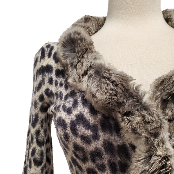 Close up of details of pre-owned Blumarine Animal Print Sweater, with fur collar.