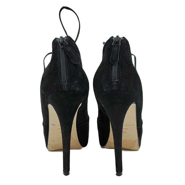 Back view of pre-owned Brian Atwood Lace-up Suede Booties in black, with skinny heels.