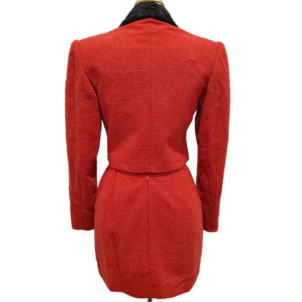 Back view of pre-owned Come Gilda Skirt Suit in red, with black collar.