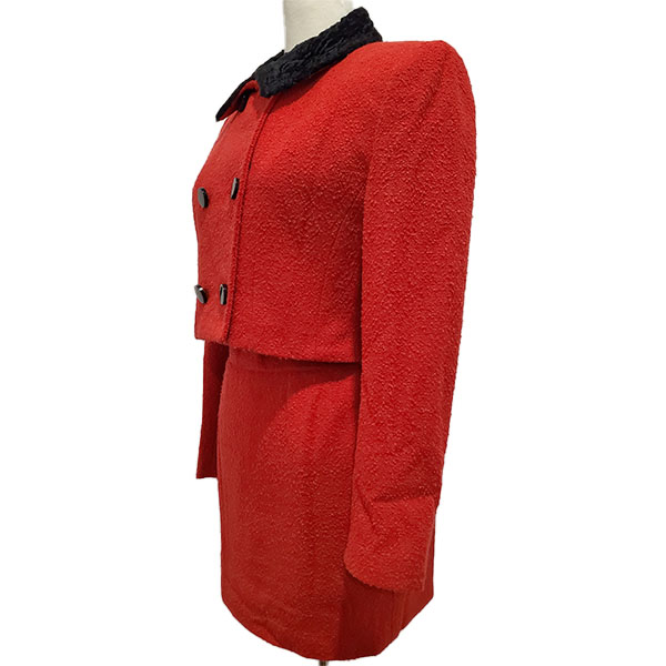 Side view of pre-owned Come Gilda Skirt Suit in red, with black collar and buttons.