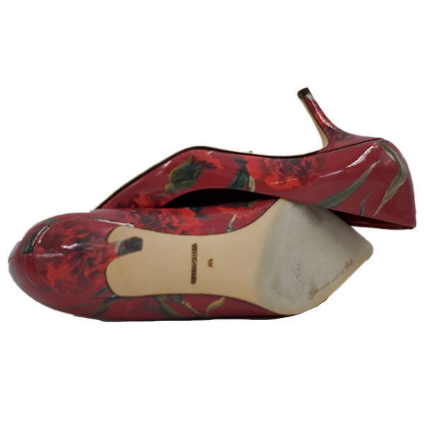 Soles of pre-owned Dolce & Gabbana Patent Leather Floral Pumps.