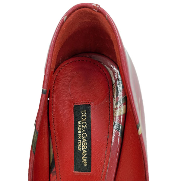 Logo of pre-owned Dolce & Gabbana Patent Leather Floral Pumps.