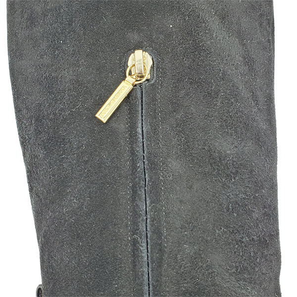 Close up of on sale pre-owned black Dolce & Gabbana Suede Knee-high boots, with zipper detail.