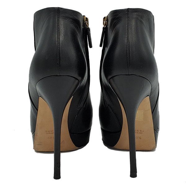 Back view of on sale pre-owned Gucci Black Ankle Booties with side zip closure and gold-tone hardware.