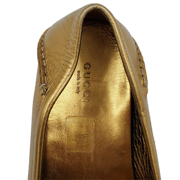 Back view close up of on sale pre-owned Gucci Metallic Gold Loafers, with horsebit details and toning stitching.