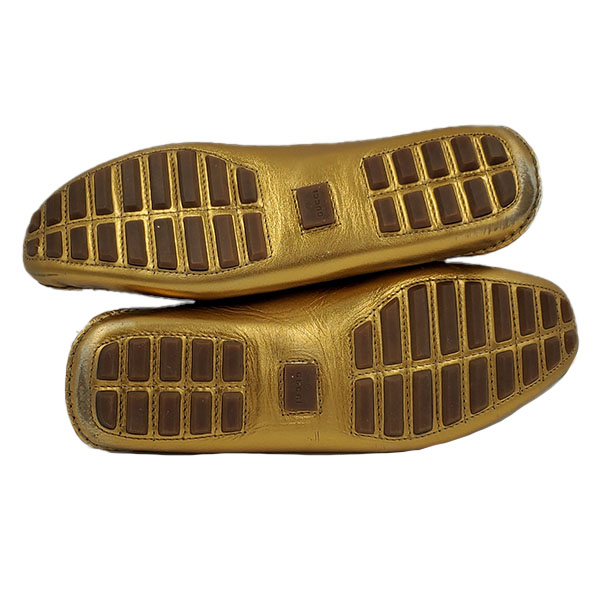 Soles of on sale pre-owned Gucci Metallic Gold Loafers, with horsebit details and toning stitching.