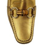 Front view close up of on sale pre-owned Gucci Metallic Gold Loafers, with horsebit details and toning stitching.