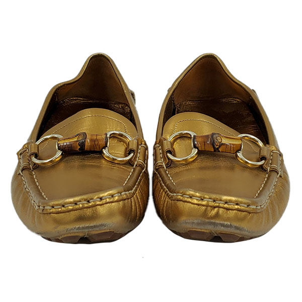 On sale pre-owned Gucci Metallic Gold Loafers, with horsebit details and toning stitching.