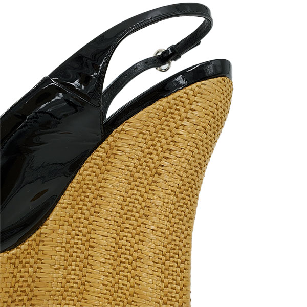 Back view of on sale pre-owned black Gucci Patent Leather Jute Wedges with adjustable ankle strap with gold tone buckle.