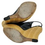 Soles of on sale pre-owned black Gucci Patent Leather Jute Wedges with adjustable ankle strap with gold tone buckle.
