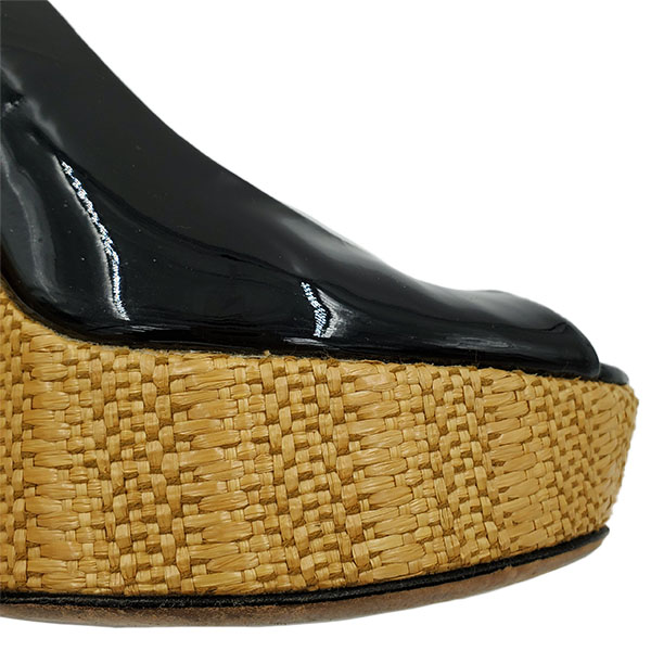 Front view of on sale pre-owned black Gucci Patent Leather Jute Wedges with adjustable ankle strap with gold tone buckle.
