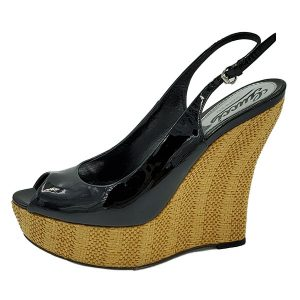 On sale pre-owned black Gucci Patent Leather Jute Wedges with adjustable ankle strap with gold tone buckle.