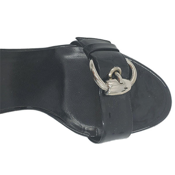 Close up front view of pre-owned Gucci Patent Leather Strappy Sandals in black, with adjustable buckle.