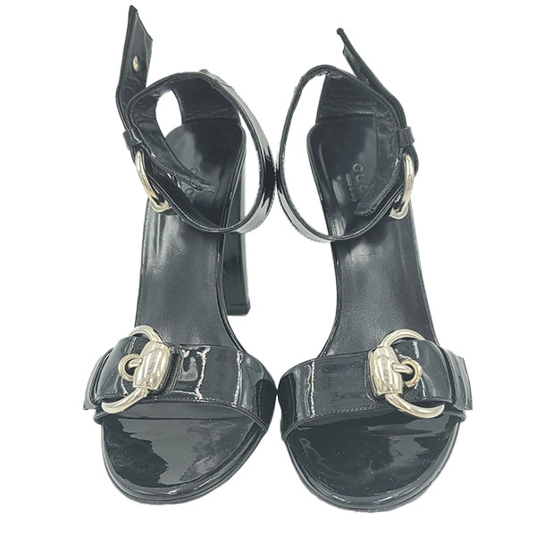 Front view of pre-owned Gucci Patent Leather Strappy Sandals in black, with adjustable buckle.