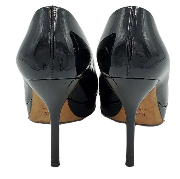 Back view of on sale pre-owned black Gucci Vintage Patent Leather Pumps, with front platform and skinny heels.