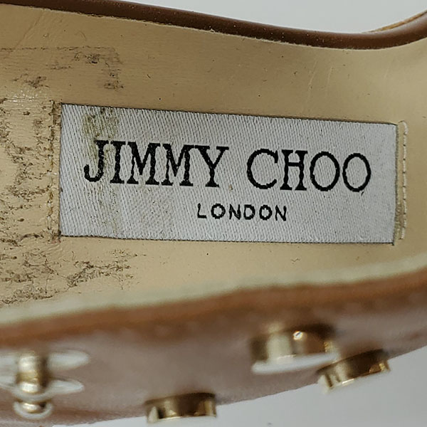 Logo of on sale pre-owned Jimmy Choo Leather Wedge Sandals in tan leather, with gold-tone studs.