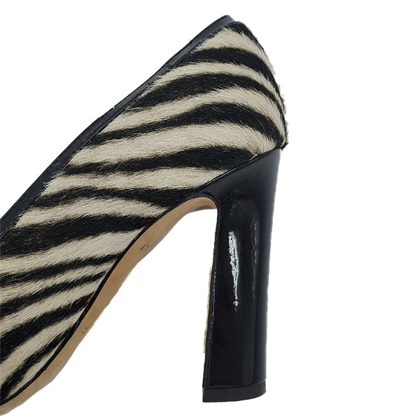 Close up back view of on sale pre-owned Kate Spade Animal Print Pumps with Bow, with black and white zebra print.