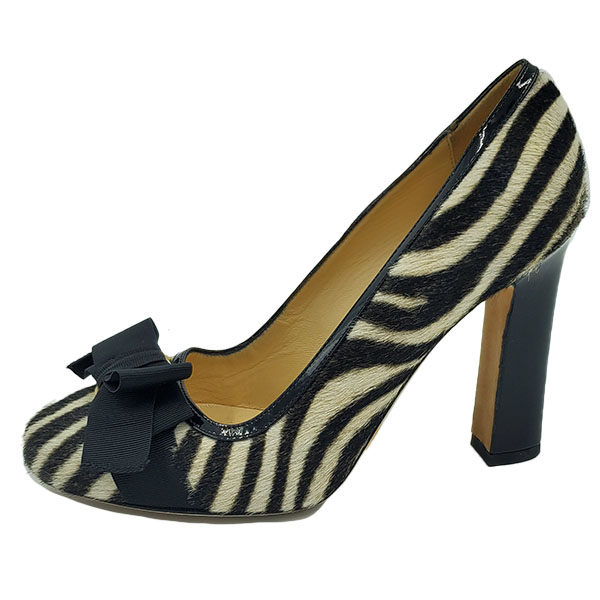 On sale pre-owned Kate Spade Animal Print Pumps with Bow, with black and white zebra print.