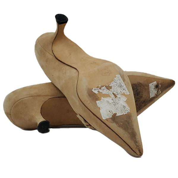 Soles of pre-owned Manolo Blahnik Suede Kitty Heels.