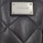 Logo of pre-owned Michael Kors Quilted Leather Cellphone Wristlet.