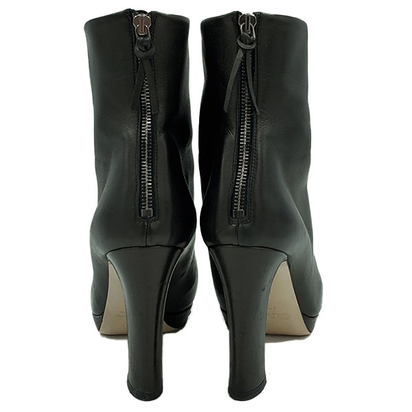 Back view pre-owned Miu Miu Ankle Leather Booties in black, with back zip closure.