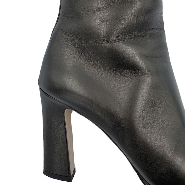 Close up back view of pre-owned Miu Miu Ankle Leather Booties in black.
