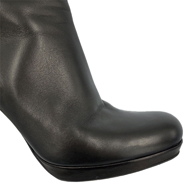 Close up front view of pre-owned Miu Miu Ankle Leather Booties.