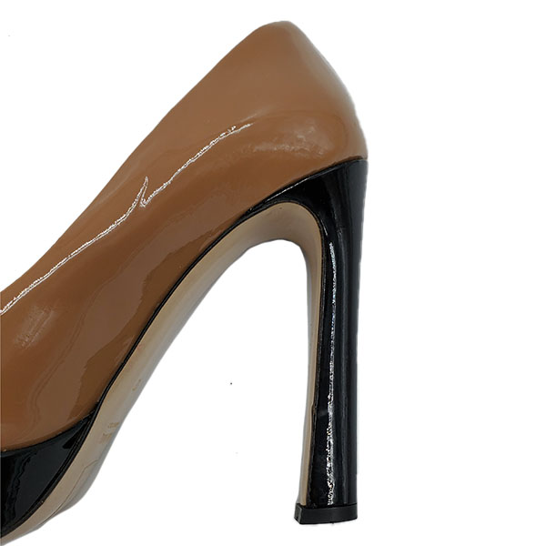 Close up back view of on sale pre-owned Miu Miu Shiny Leather Colour-Block Pumps, in black and tan.