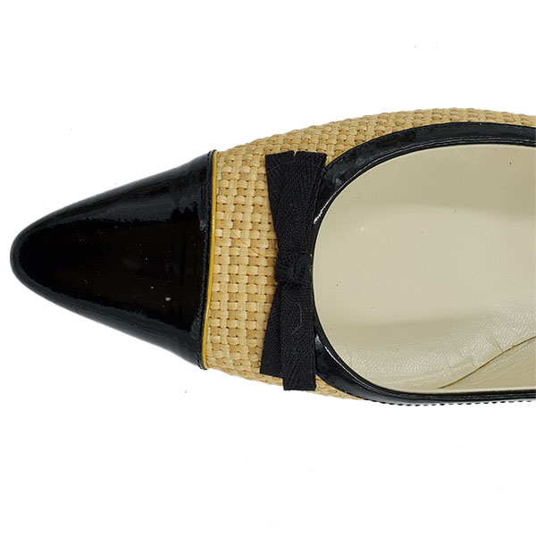 Close up front view of on sale pre-owned Prada Pointed Toe Bow-tie Flats in black and nude.