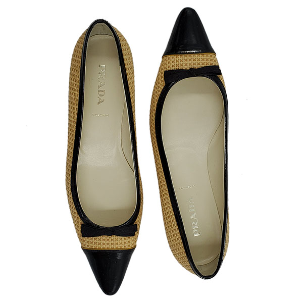 Top view of on sale pre-owned Prada Pointed Toe Bow-tie Flats in black and nude.