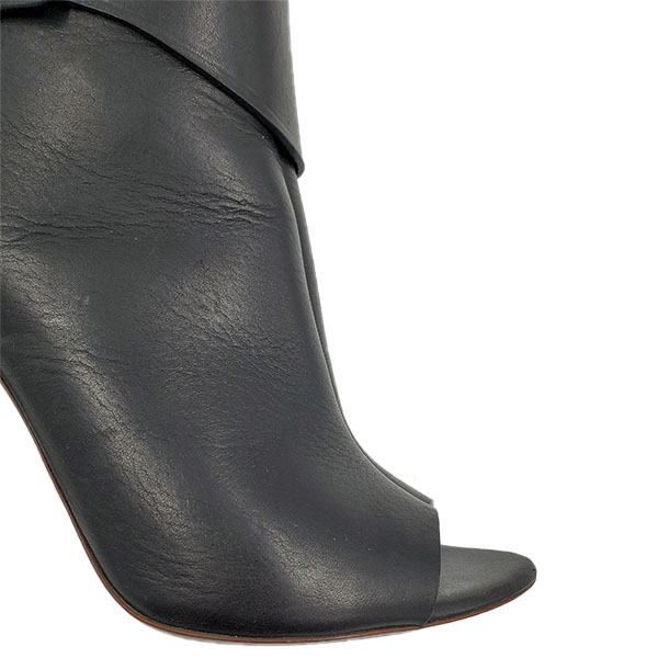 Close up front view of on sale pre-owned Proenza Schouler Open-toe Booties in black, with silver zipper.