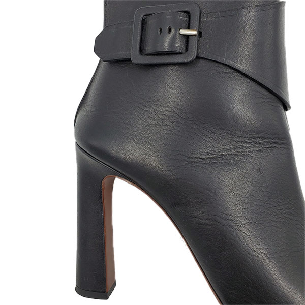 Close up back view of on sale pre-owned Proenza Schouler Open-toe Booties in black, with buckle details.