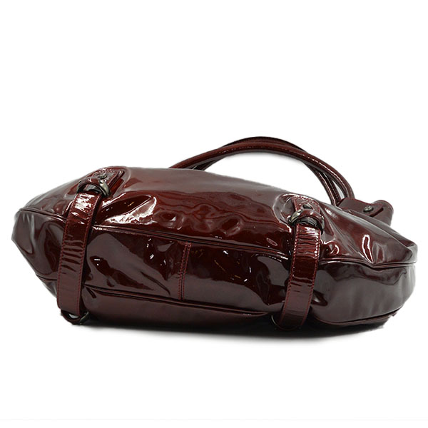 Underside of pre-owned Salvatore Ferragamo Patent Leather Hobo Bag.
