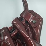 Close up details of pre-owned Salvatore Ferragamo Patent Leather Hobo Bag.