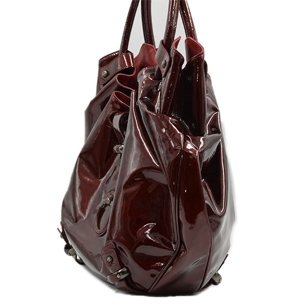 Side view of pre-owned Salvatore Ferragamo Patent Leather Hobo Bag in crimson, with gunmetal hardware.