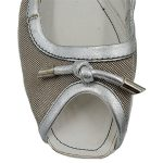 Top view of pre-owned Tod's Canvas With Leather Trim Flats in beige and white, with bow in front.