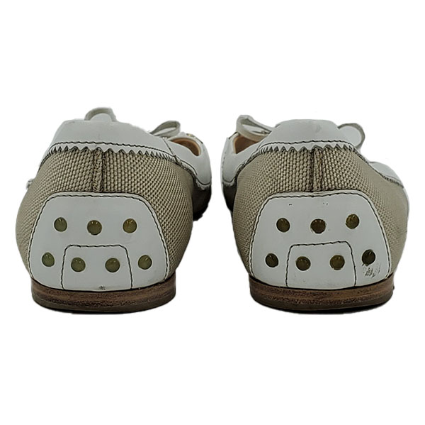 Back view of pre-owned Tod's Crisscross Slippers in off-white.