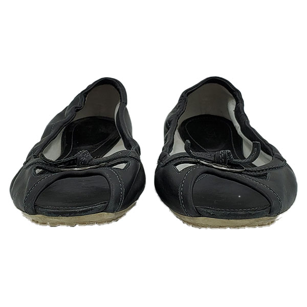 Front view of pre-owned Tod's Open-toe Leather Flats in black.