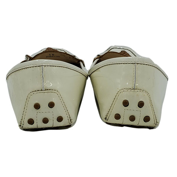 Back view of pre-owned Tod's Patent Leather Loafers in white.