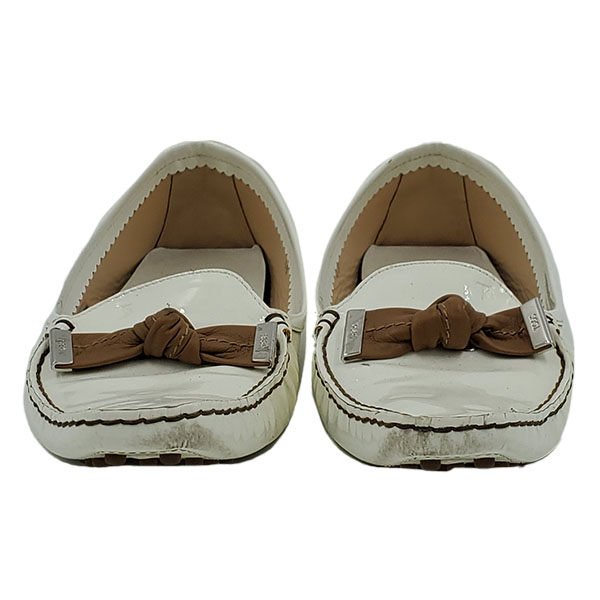 Front view of pre-owned Tod's Patent Leather Loafers in white, with brown bow and silver hardware.