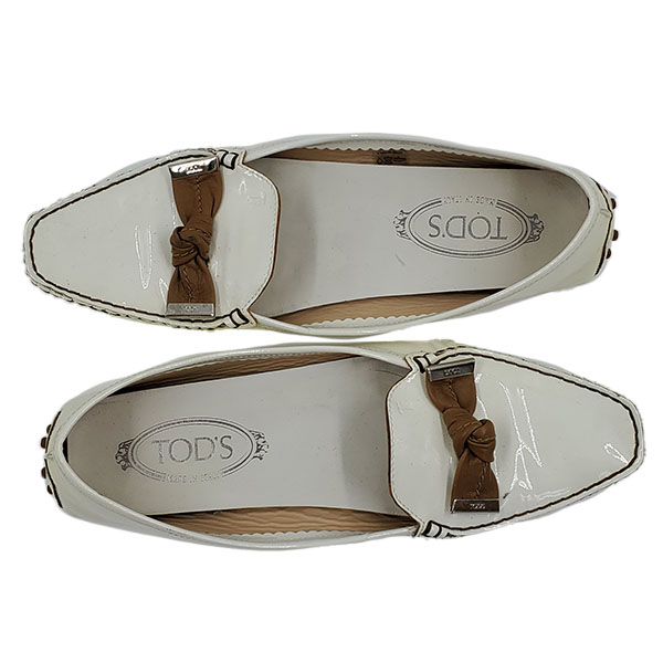 Top view of pre-owned Tod's Patent Leather Loafers in white, with brown bow and silver hardware.